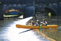 Family canoeing over weir on river Brantome Royalty Free Stock Photo