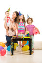 Family celebrate first year birthday of boy with cake and balloons Stock Photo