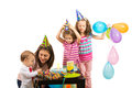 Family celebrate first year of boy with cake and balloons Royalty Free Stock Photo