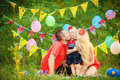 Family celebrating birthday party in green park outdoors portrait of a happy having fun together Royalty Free Stock Image