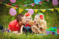 Family celebrating birthday party in green park outdoors portrait of a happy having fun together Royalty Free Stock Photo