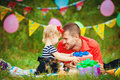 Family celebrating birthday party in green park outdoors portrait of a happy having fun together Royalty Free Stock Photos