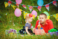 Family celebrating birthday party in green park outdoors portrait of a happy having fun together Royalty Free Stock Images