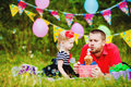 Family celebrating birthday party in green park outdoors portrait of a happy having fun together Stock Photography
