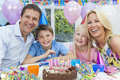 Family Celebrating Children's Birthday Party Cake Stock Photography