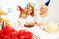 Family celebration of girl's birthday