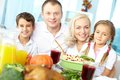 Family celebration portrait of happy sitting at festive table and looking at camera Royalty Free Stock Image