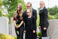 Family on cemetery mourning deceased relative or graveyard Royalty Free Stock Photography
