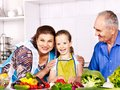 Family with child cooking at kitchen grandfather and grandmother Stock Image