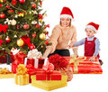 Family with child near Christmas tree. Stock Image