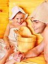 Family with child relaxing at sauna. Stock Photography