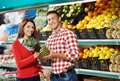 Family with child shopping fruits Royalty Free Stock Photo