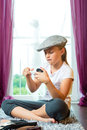 Family - child sitting with cap in room Royalty Free Stock Photography