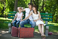 Family  children on bench in park. Royalty Free Stock Photo