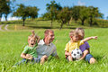 Family with children and football on a meadow Royalty Free Stock Photo