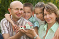 Family with children is keeping wendy house Royalty Free Stock Photography