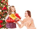 Family with children open gift box near christmas tree happy isolated Royalty Free Stock Photography