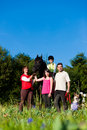 Family and children posing with horse Royalty Free Stock Images