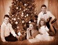 Family with children  receiving gifts . Royalty Free Stock Photography