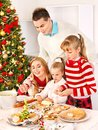 Family with children rolling dough in Xmas Royalty Free Stock Photography