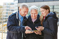 Family on city trip navigating with map and smartphone app Royalty Free Stock Images