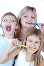 Family cleaning teeth Royalty Free Stock Photo