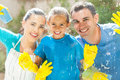 Family cleaning window happy young of three home glass together Stock Images