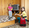 Family is cleans living room Royalty Free Stock Photo