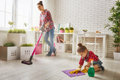 Family cleans the room Royalty Free Stock Photo