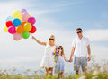 Family with colorful balloons summer holidays celebration children and people concept Royalty Free Stock Image