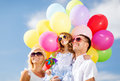 Family with colorful balloons summer holidays celebration children and people concept Stock Images