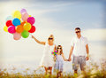 Family with colorful balloons summer holidays celebration children and people concept Royalty Free Stock Photo