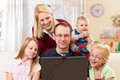 Family with computer having video conference Royalty Free Stock Photography