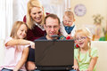 Family with computer having video conference Royalty Free Stock Photos