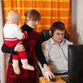 Family with  computer  at home Royalty Free Stock Photos