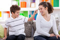 Family conflict boy plucked hair his sister Royalty Free Stock Image