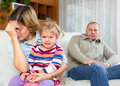 Family conflict dismal women with children against husband after quarrel at home Stock Photo