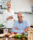 Family conflict in kitchen sad men and women during quarrel at home Royalty Free Stock Images