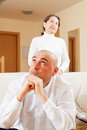 Family conflict middle aged couple after quarrel in living room at home Stock Photos