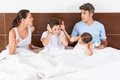 Family conflict parents bed, couple children Royalty Free Stock Photo