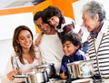 Family cooking at home Stock Image