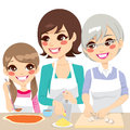 Family cooking pizza together daughter mother and grandmother a delicious homemade with fresh ingredients Stock Image