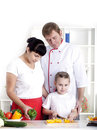 Family cooking together Stock Images