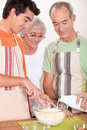 Family cooking together in the kitchen Stock Photography