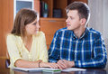 Family couple at desk with financial documents indoors Royalty Free Stock Photo