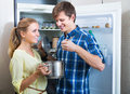 Family couple opened fridge and looking food Royalty Free Stock Photo