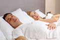 Family couple sleeping in bed hotel travel relationships and problems with sleep concept women with insomnia Stock Image