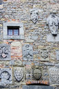 Family Crests on Stone Wall