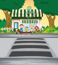 Family crossing road near coffee shop Royalty Free Stock Photography