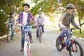 Family on cycle ride in countryside smiling Stock Photo